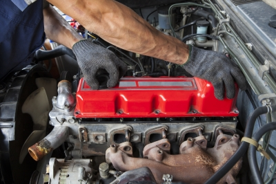 Hand Repair And Maintenance Cylinder Diesel Engine Of Light Pick Stock Photo