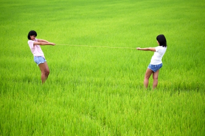 Tug Of War Between Two Girls Stock Photo